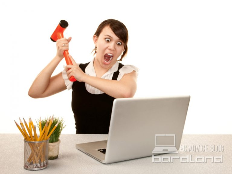 Woman threatening to hit the computer